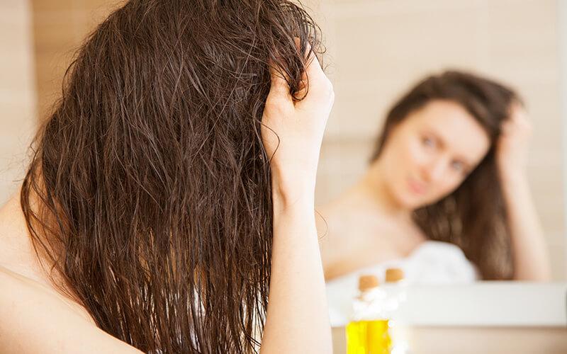 applying scalp oil