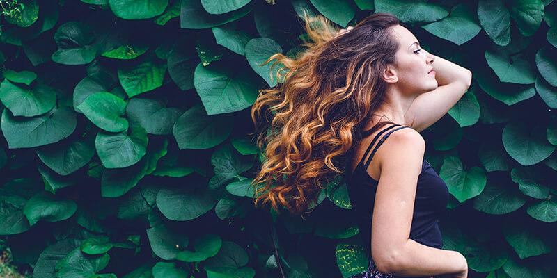 Girl against leaf background
