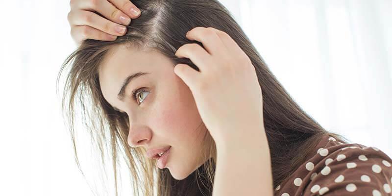 girl inspecting scalp