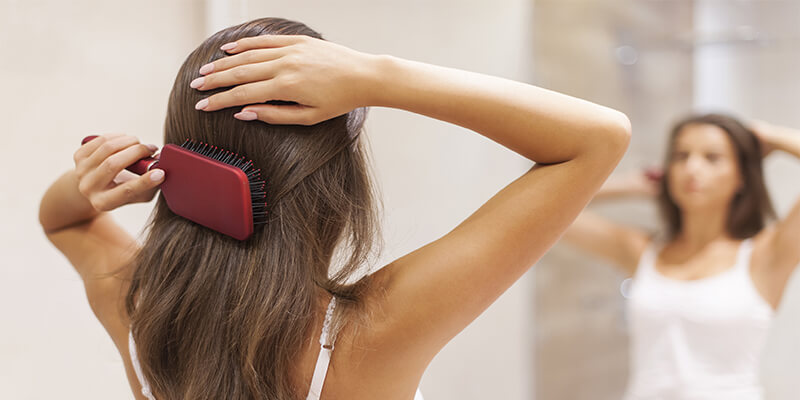 Women Brushing Her Hair