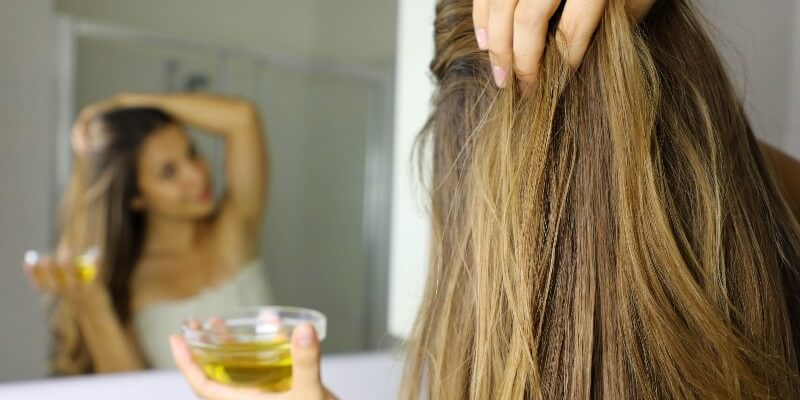 applying oil to scalp